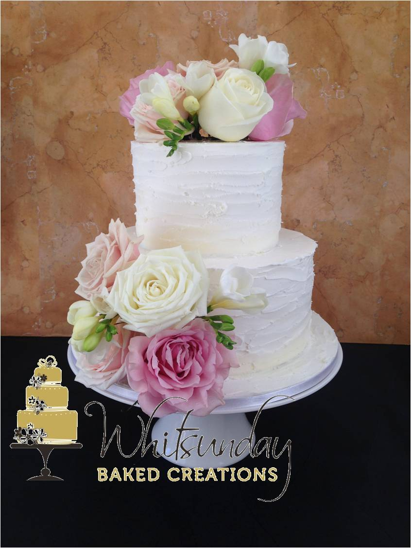 2 tier wedding cakes with flowers whitsunday baked creations 10174